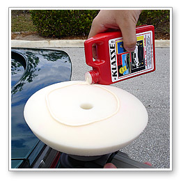 Mist a white polishing pad with water or Wolfgang Instant Detail Spritz. Apply a nickel size amount of Klasse All In One to the perimeter of the pad.