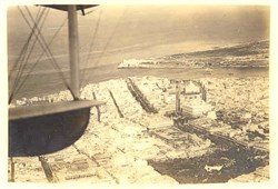 Early Bi Plane Photo Postcard Flying over City