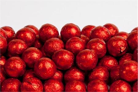 Red Foiled Milk Chocolate Balls (25 Pound Case)
